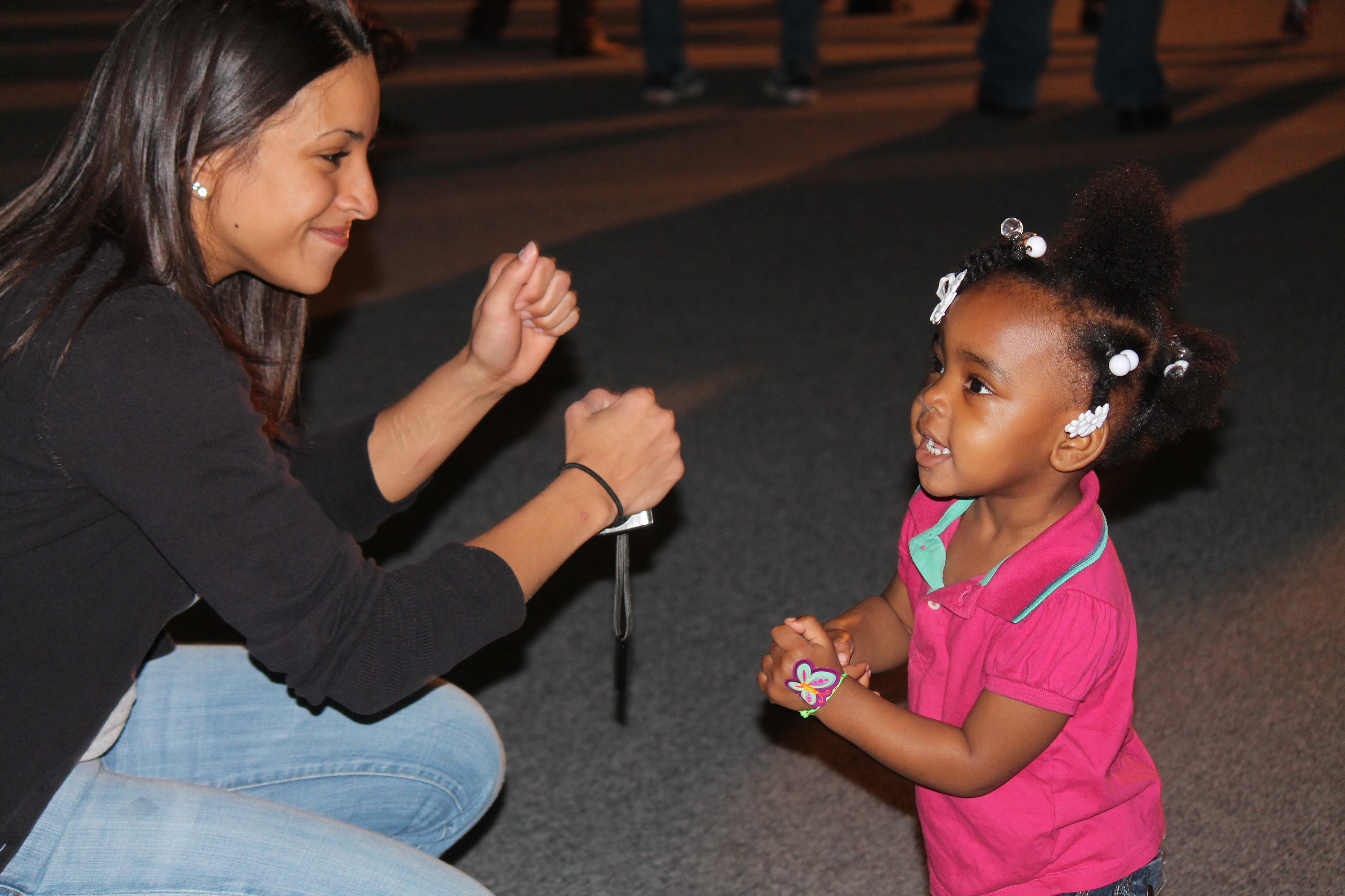 young woman playing with small child