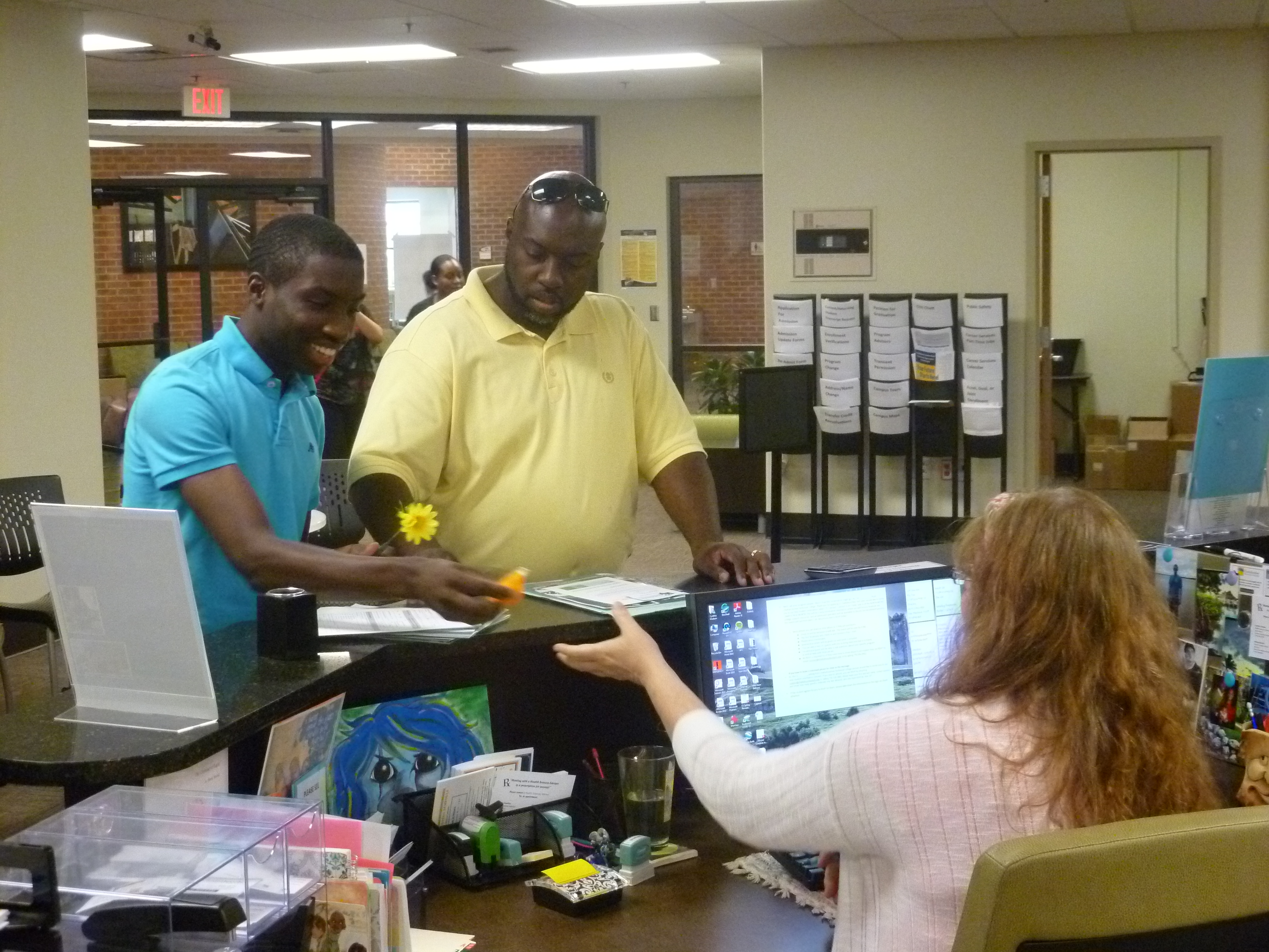 Student affairs helping 2 students at North Metro