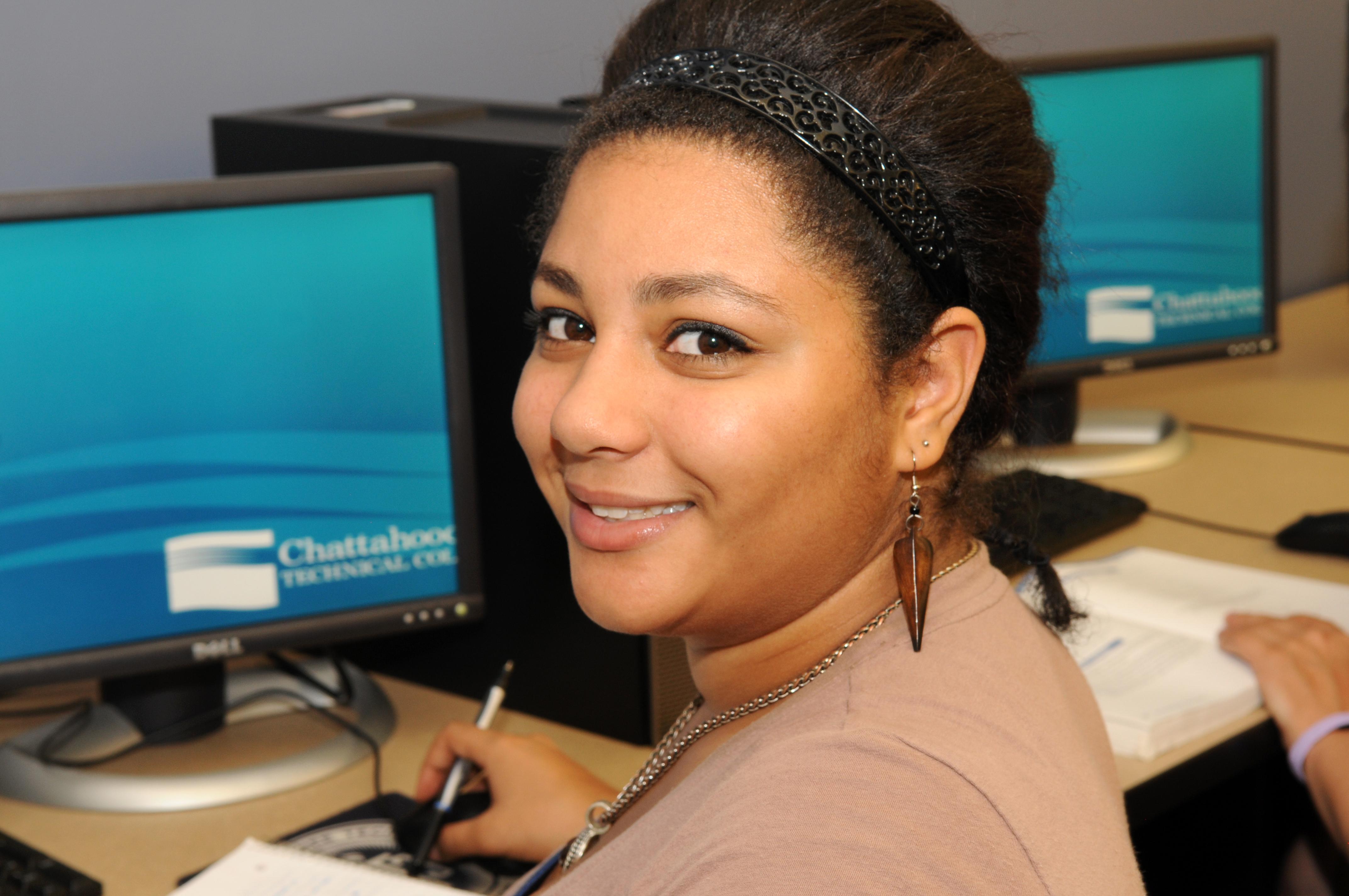 female smiling at CTC desks