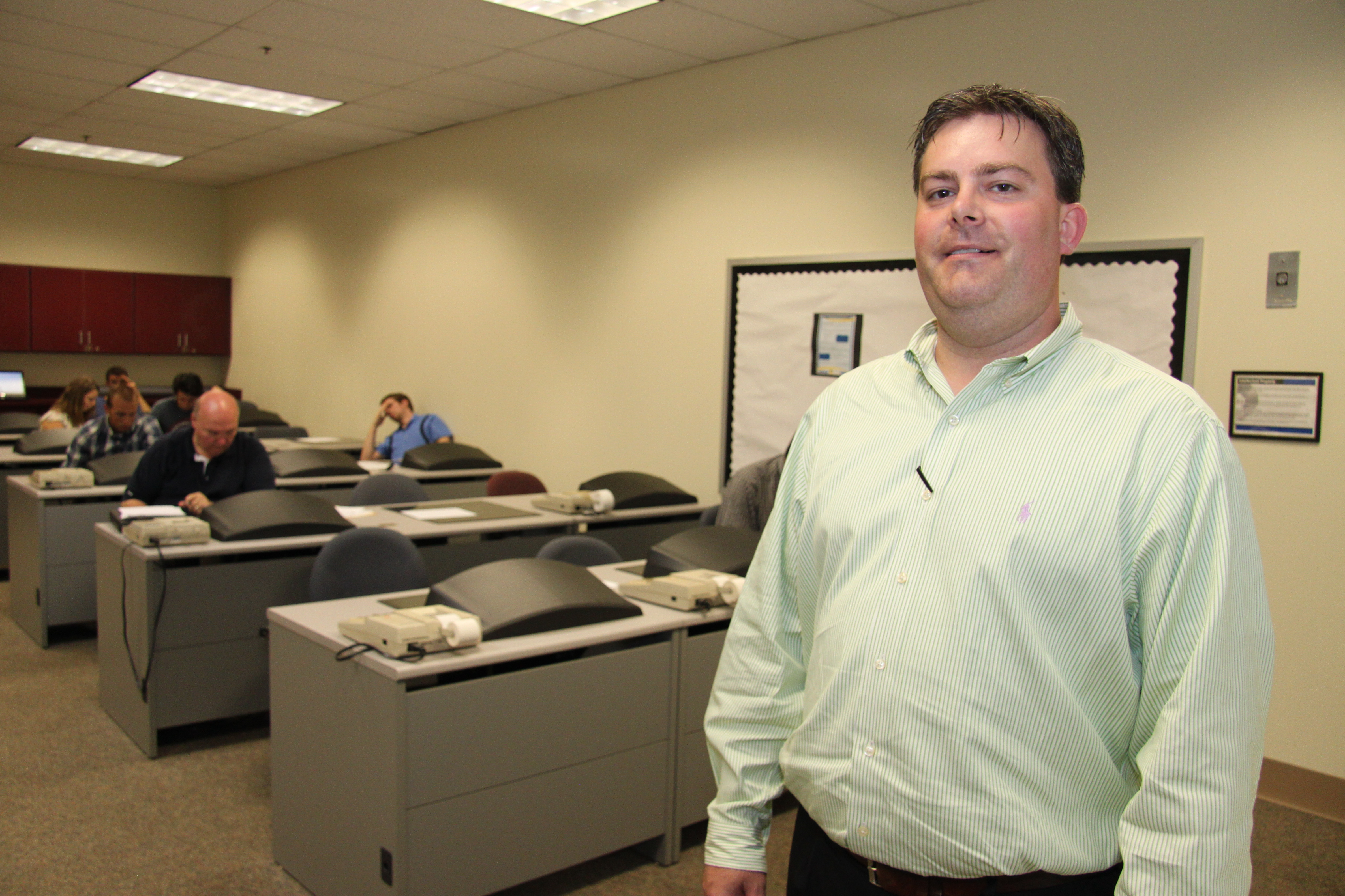 Jason Tanner in front of classroom