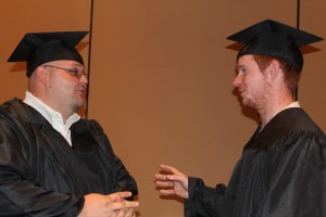 Diesel Equipment Technology graduates Brett Chastain and Everett Morgan chat before the June 3 ceremony.
