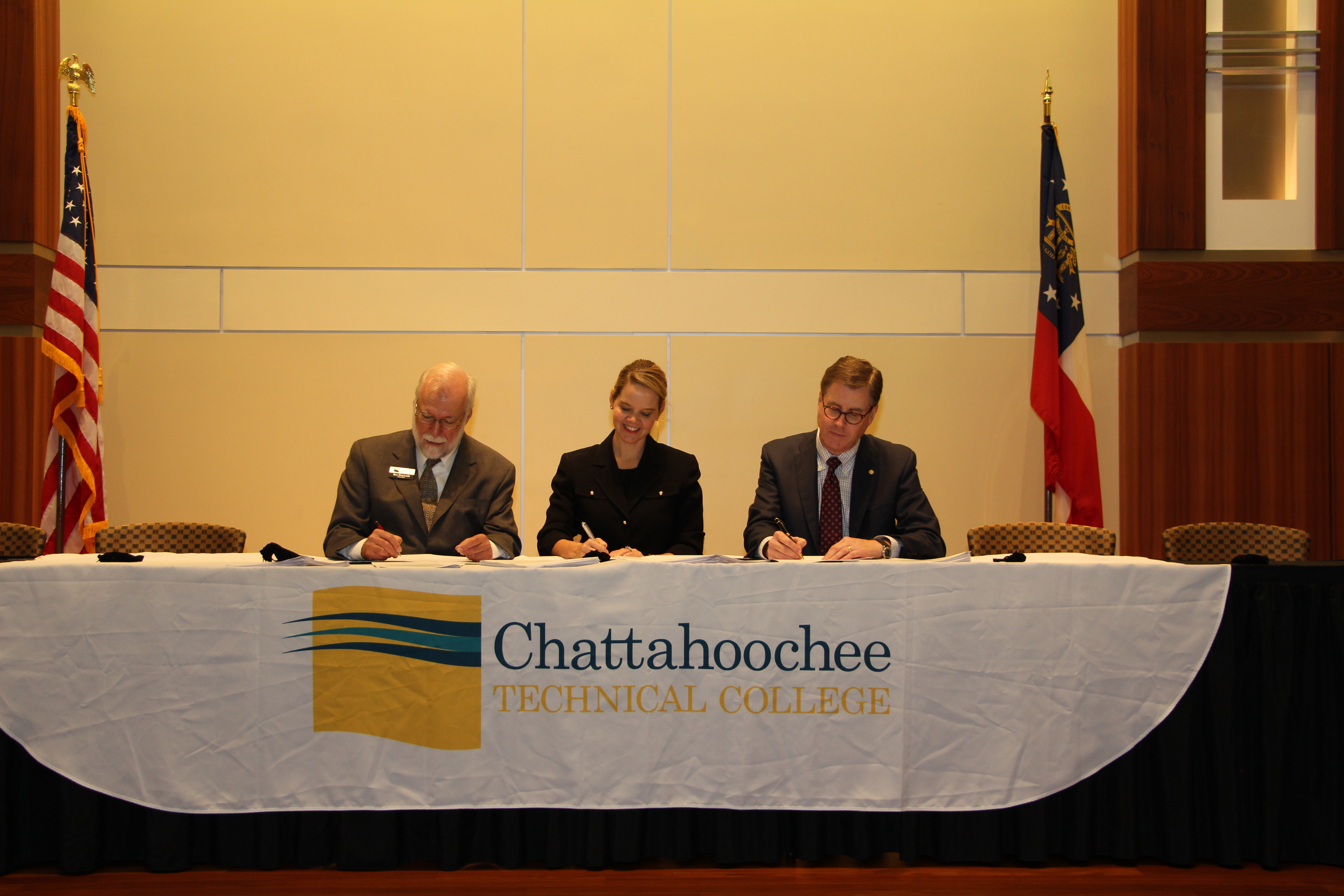 Chattahoochee Technical College (CTC) held an articulation agreement signing ceremony with Valdosta State University (VSU) on Monday, Nov. 9, following the quarterly Cartersville/Bartow Chamber Luncheon at the Clarence Brown Conference Center in Cartersville. From left, CTC President Dr. Ron Newcomb, Technical College System of Georgia (TCSG) Commissioner Gretchen Corbin, and VSU President Cecil P. Staton sign the agreements that will allow CTC students to continue their college education by taking online courses with VSU.