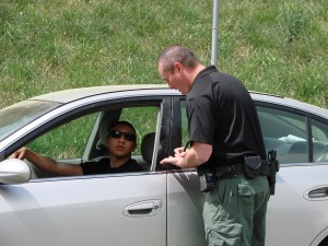 During a SkillsUSA Georgia event, Chattahoochee Technical College student Michael Wells performs a traffic stop on Cobb County Police Explorer Oscar Escarcega, of Marietta.