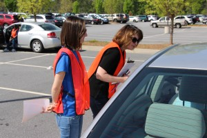 Lauren Lameier, of Cherokee County (in the CTC shirt) and Ginny Bush, RN in WellStar's Emergency Department, performing a car safety check