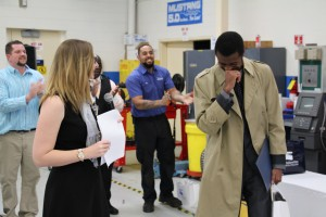 AutoNation Market Human Resources Manager Kristen Sowemimo announces Automotive Technology student Emmanuel Unachukwu as the Student of the Year.