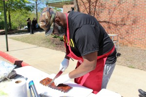 Antoine Guerrier, pictured, and his teammate Frank Brown earned a first-place finish in the Trash Can BBQ Competition.