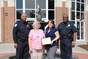 Pictured, from left, are CTC Police Chief Charles Spann, Financial Aid Specialist Barbara Lyle, Financial Administrator Eilla Torres, and Deputy Chief Al Campbell.