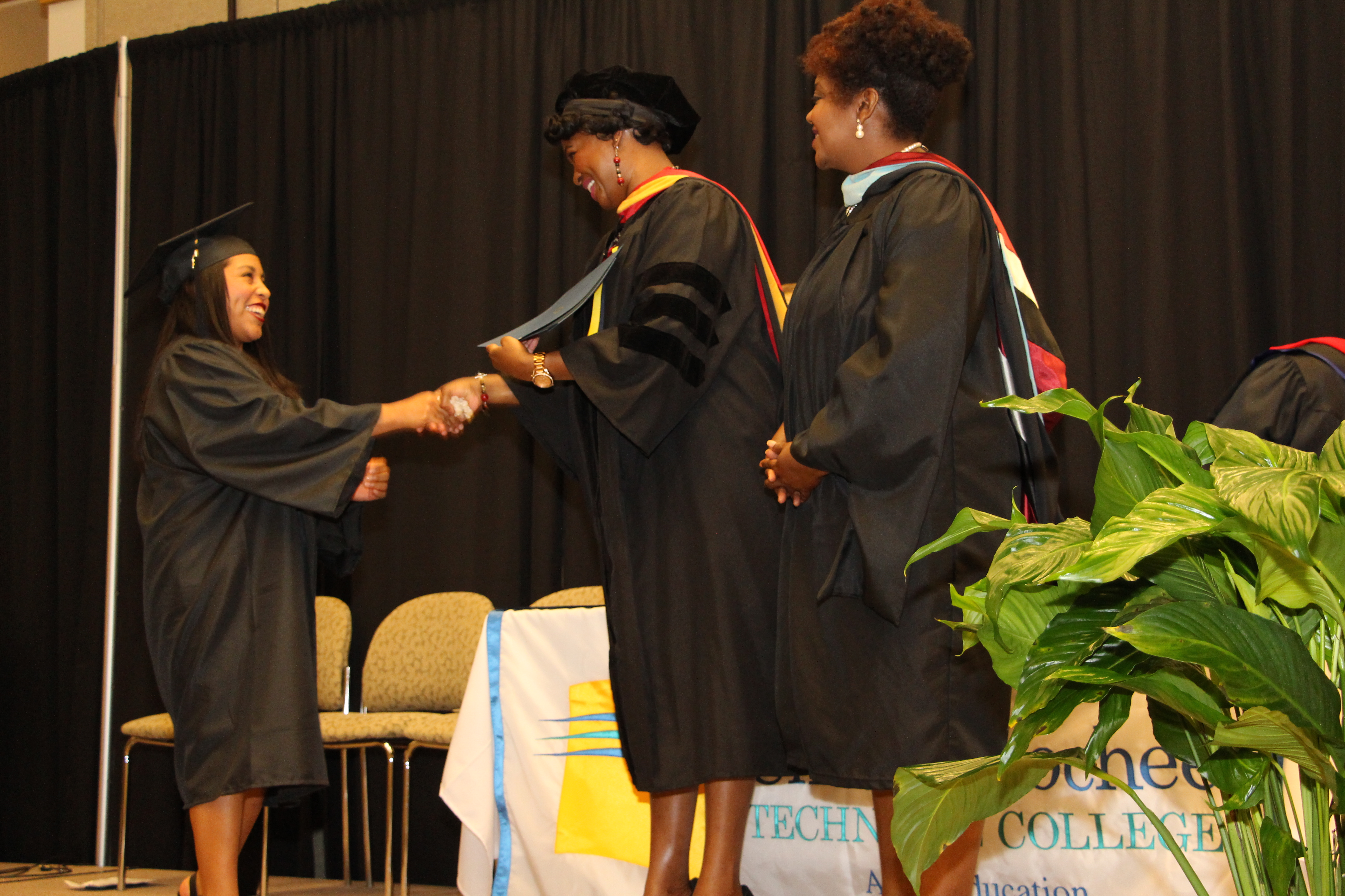 Photo of student receiving diploma at graduation
