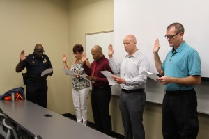 Deputy Chief Campbell swears in Diane Herndon,  Michael Evans, Matt Henson and  Brian Collins.