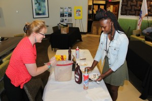 Chattahoochee Technical College welcomed back its students at the North Metro Campus with an ice cream social. Pictured is CTC Instructor Amy Ward dishing up some ice cream for Kennesaw resident and student Lyrics Dundy.