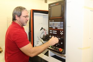 hattahoochee Technical College's CNC Technology instructor Jack Dempsey works on installing new equipment in the program's lab, located on the North Metro Campus.