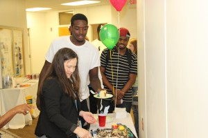 From left, CTC Director of Libraries Leigh Hall serves student Jordan Oliver during Wednesday's open house. Student Chuma Onyeagba, right, looks on as he waits in line.