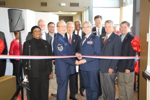 Pictured cutting the ribbon with CTC Communication and Veteran Services Coordinator Dr. Barry Munday is Col. Patricia Ross, USAF (ret.). Joining are Chattahoochee Tech President Dr. Ron Newcomb, second row, far left, and members of Chattahoochee Technical College's Board of Directors and the Chattahoochee Tech Foundation's Board of Trustees.