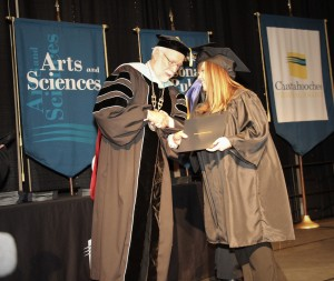 Chattahoochee Technical College President Dr. Ron Newcomb congratulates Krista Colling of Kennesaw during commencement.