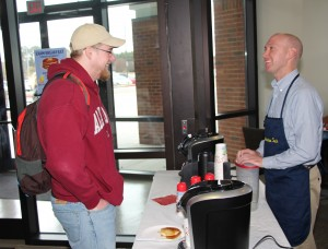 CTC student Carson Ankney of Kennesaw grabs a cup of coffee from Career Services Specialist Jesse Moyers during the pancake breakfast hosted at the North Metro Campus in Acworth.