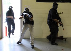 Photo of Campus Police entering the building after being alerted of a suspicious individual.