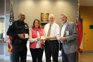 Pictured, from left, are Chattahoochee Tech Director for Alumni and Annual Giving Stephanie Hubbell, Chattahoochee Tech Chief of Police Charles Spann, Acworth Police Chief Wayne Dennard and Ben Flanagan with Lacey Drug Company.