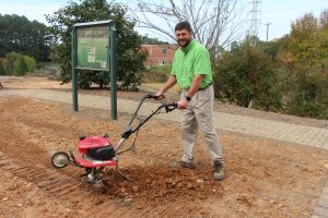 CTC Instructor with garden tiller.