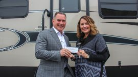 From left, Open Roads Complete RV Owner Drew Hutton and CTC Director for Alumni and Annual Giving Stephanie Hubbell.