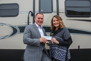 Photo, from left, of Open Roads Complete RV Owner Drew Hutton and CTC Director for Alumni and Annual Giving Stephanie Hubbell.