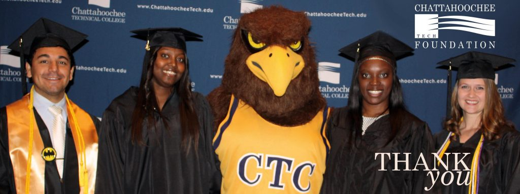 Picture of Swoop with graduates