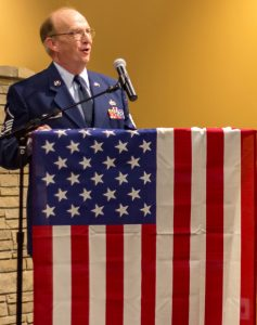 Barry Munday speaks at event for veterans.