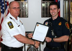 Cherokee County Fire Chief presents award.