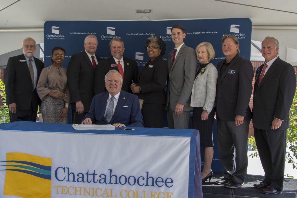 Officials gather with Gov. Deal as he signs House Bill 684 at the Chattahoochee Tech North Metro campus in Acworth.