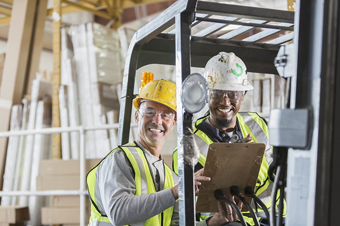 two men with forklift
