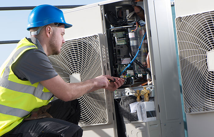 Air Conditioning tech working on equipment