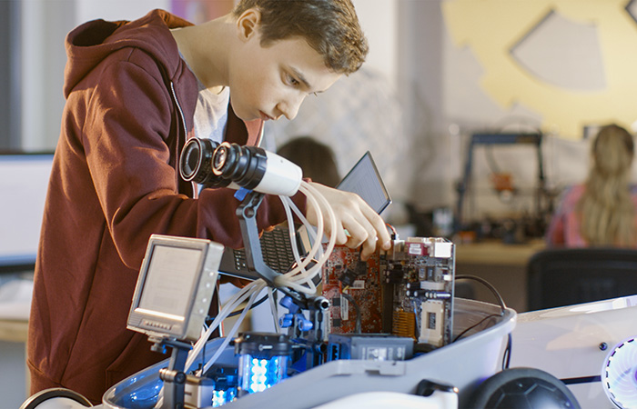 Young male student working on Robotics project