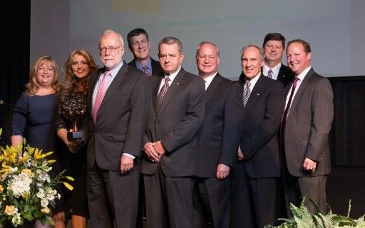 Pictured, first row, from left, are: Christine Mullinax, Chairman of Chamber for 2016 – Cobb EMC, Stacy Hamby, President Paulding Chamber, Dr. Ron Newcomb, CTC Board of Directors members Tyre Rakestraw, Mark Haney, Steve Crew, and  CTC Board of Trustee member Ford Thigpen; back row:  Mike Mason,  Mason Law Firm and incoming Paulding Chairman for 2017.