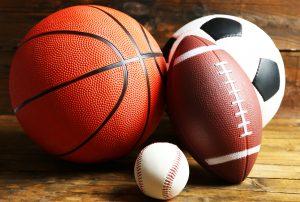 Picture of baseball, softball, soccer ball, football
