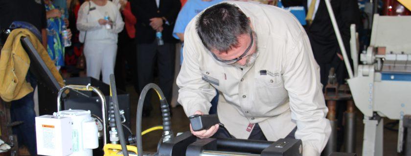 CTC instructor Jim Thomas works with destructive test equipment.