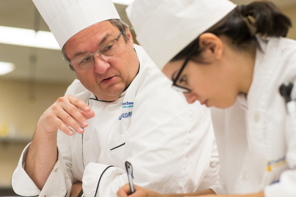 Culinary Arts chef with student