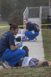 Photo of a student assisting another student in distress.