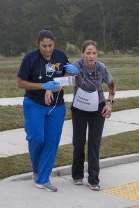Photo of student assisting another student during the mass casualty training event.