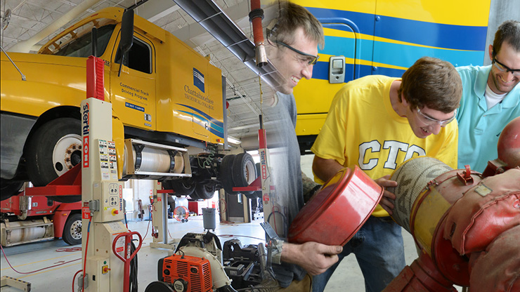 Diesel Equipment Technology truck and students working
