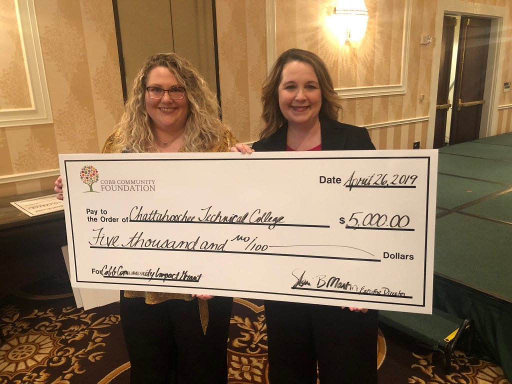 Receiving the grant check were Amanda Henderson and Stephanie Hubbell.