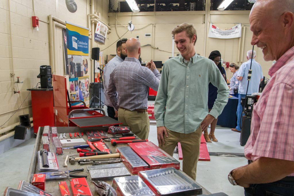 Award winner Stuart Seiler admires the Snap-on tool set with Alan Peterson.