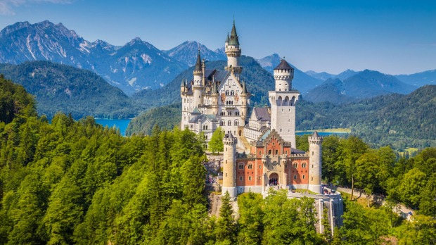 Picture of neuschwanstein castle with mountains in background