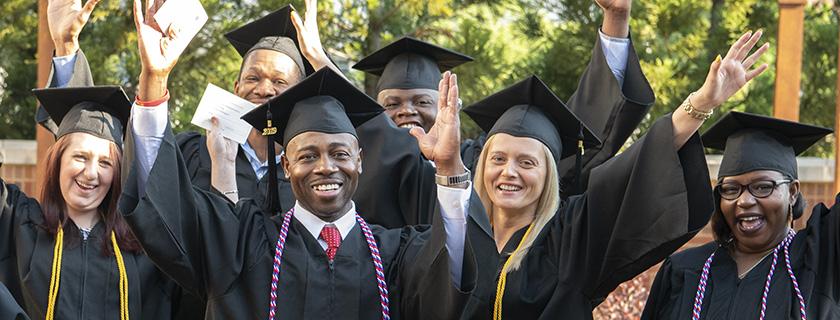 Group of happy graduates.