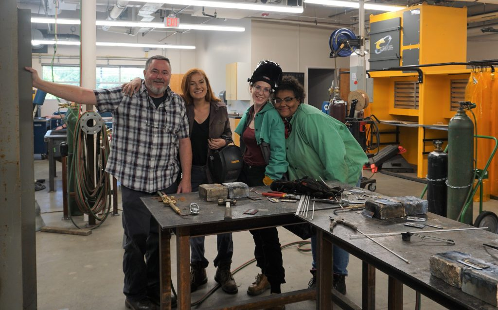 Welding Instructor James Thomas and students.