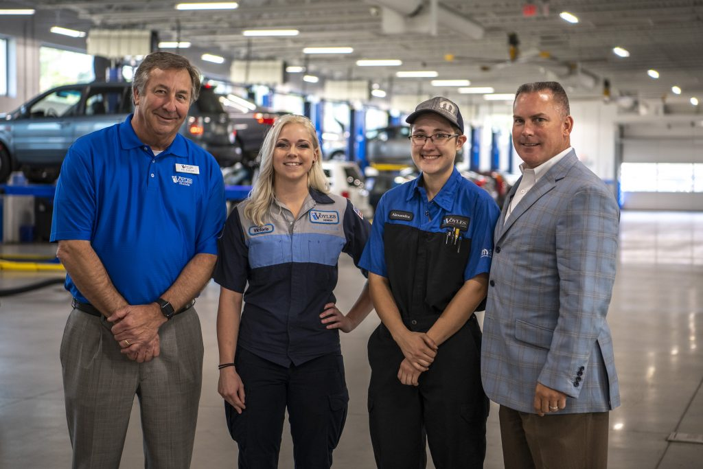 Shown here, l-r, are Ed Voyles Honda General Manager Pete Richards, Sweeton, Cote, and Ed Voyles CDJR General Manager Drew Tutton.