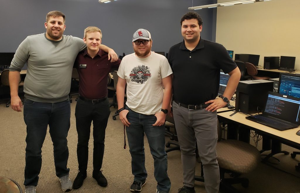 The winning team from Chattahoochee Tech in the recent CompTIA cybersecurity competition included, l-r, students Will Duncan, Michael Grimes and Kevin Borah, along with their faculty advisor Max Trivers.