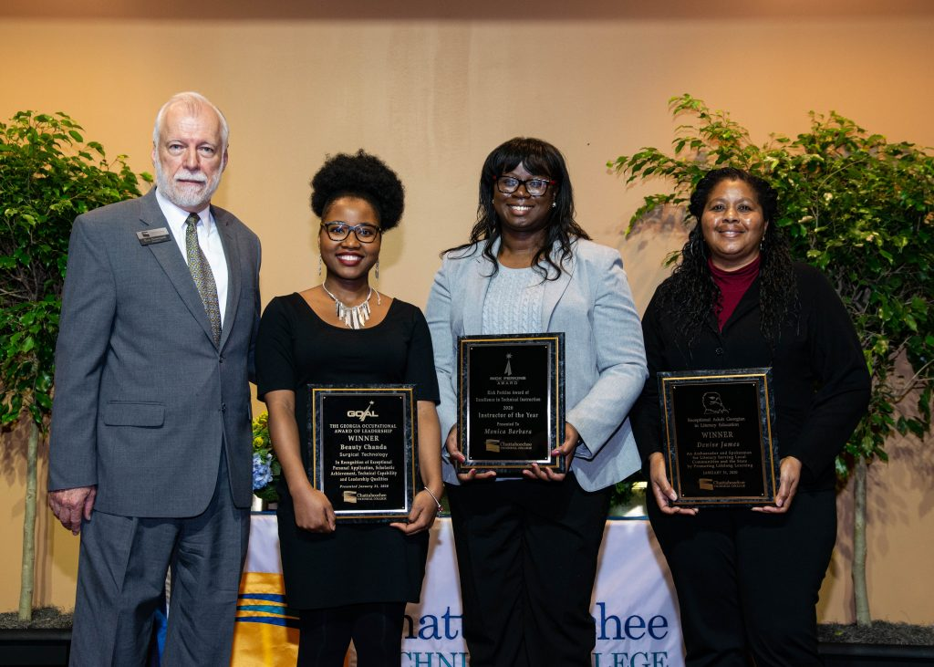 Chattahoochee Tech announced the college's 2020 GOAL, Rick Perkins Award and EAGLE winners at an awards event Friday, Jan. 31. Shown here, l-r, are Chattahoochee Tech President Dr. Ron Newcomb, GOAL winner Beauty Chanda, Rick Perkins Award winner Monica Barbara, and EAGLE winner Denise James.