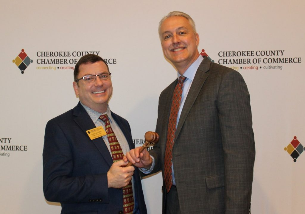 John Barker, the immediate past chairman of the board of directors for Cherokee Chamber of Commerce, passed the gavel to new the new chairman, David Simmons.