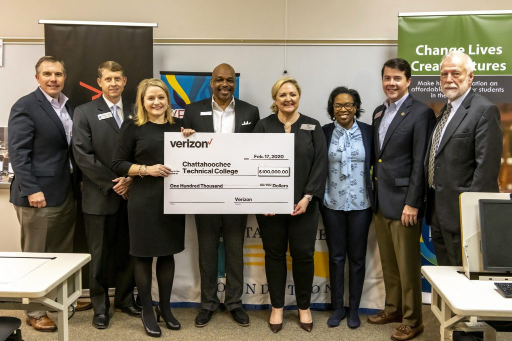 Officials who gathered for the Verizon Foundation $100,000 grant presentation included, shown here from left to right, Chattahoochee Tech Foundation Vice Chair Mark Goddard, TCSG Commissioner Greg Dozier, State Rep. Matthew Gambill, Verizon Director of Government Affairs Julie Smith, City of Acworth Alderman Tim Houston, Georgia Public Service Commissioner Tricia Pridemore, Michelle Arrington, of Verizon, State Rep. Matthew Gambill, and Chattahoochee Tech President Dr. Ron Newcomb.
