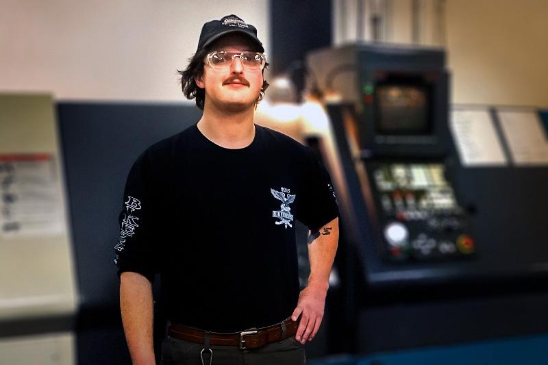 Man standing near machinery