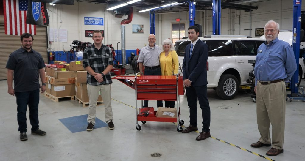Justin Messenger and Alex Johnson receive tool sets.